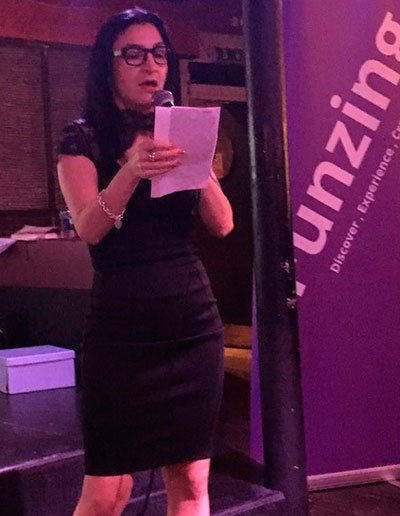 Image of Mine speaking at an event at Funzing