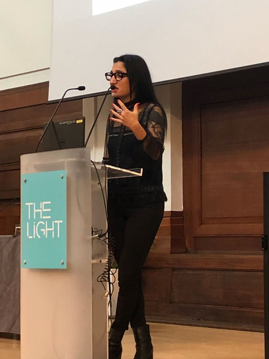 Image of Mine presenting at an event at The Light Auditorium, London